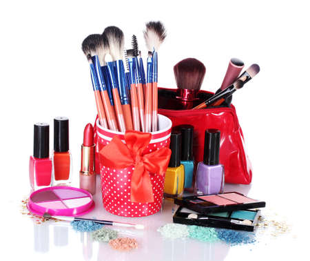 make-up brushes in cup and cosmetics isolated on white Stock Photo - 13556895