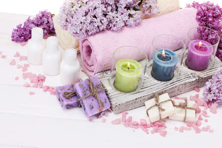 natural cosmetics: beautiful spa setting on white wooden background