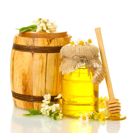 wood barrel: Sweet honey in barrel and jar with acacia flowers isolated on white