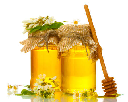 Sweet honey in jars and acacia flowers isolated on white Stock Photo - 13605071