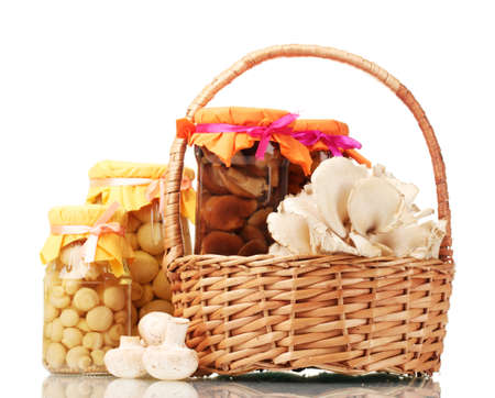 delicious marinated mushrooms in the glass jars, raw champignons and oyster mushrooms in basket isolated on white Stock Photo - 13604211