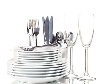 clean dishes: Clean plates, glasses and cutlery isolated on white Stock Photo