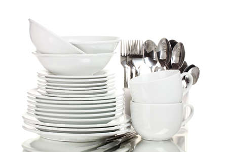 Clean plates, cups and cutlery isolated on white