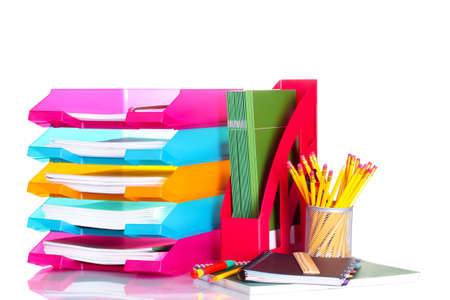 secretary tray: bright paper trays and stationery isolated on white