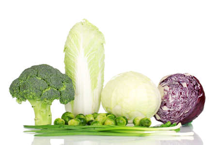 Fresh cabbages, broccoli and green onions isolated on white Stock Photo