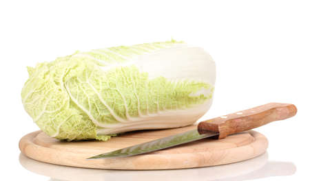 Green cabbage on wooden chopping board isolated on white Stock Photo - 13603567