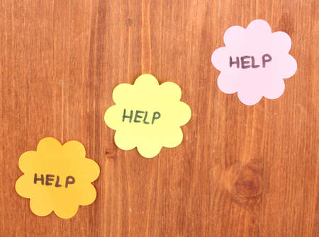 Help written on stickers on wooden background photo