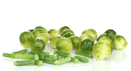 Fresh brussels sprouts and french bean isolated on white Stock Photo - 13647903
