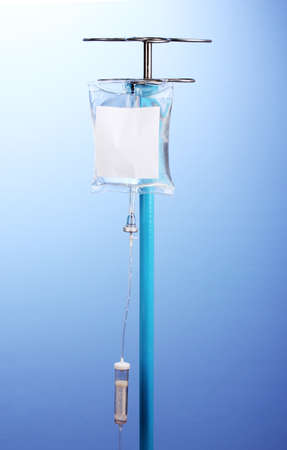 Intravenous therapy on blue background photo
