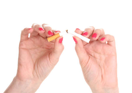 Cigarette in female hand isolateed on white Stock Photo - 13647849