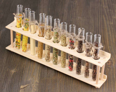 Various spices in tubes on wooden background photo