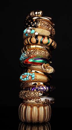 Beautiful golden bracelets isolated on black background Stock Photo - 13649253