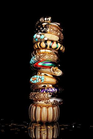 Beautiful golden bracelets isolated on black background Stock Photo - 13649142