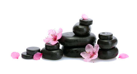 Spa stones with drops and pink sakura flowers isolated on white Stock Photo - 13647730