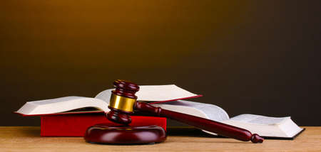 Judge's gavel and books on wooden table on brown background Stock Photo - 13648576