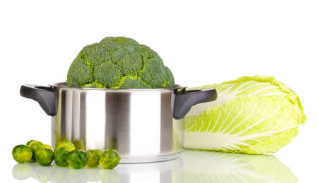 Fresh broccoli in saucepan and cabbages isolated on white Stock Photo - 13687197