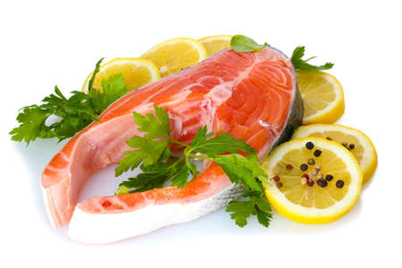 Red fish with lemon, parsley and pepper isolated on white  Stock Photo - 13687204