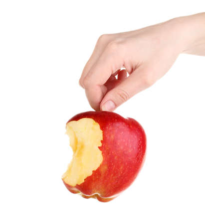 Red bitten apple in hand isolated on white