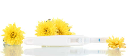 pregnancy test and flowers isolated on white photo