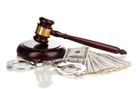 Dollar banknotes, handcuffs and judges gavel isolated on white photo