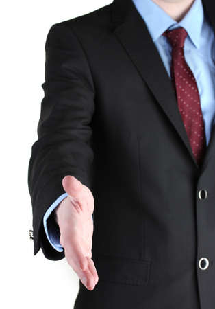 Businessman giving his hand for a handshake isolated on white Stock Photo - 13687178