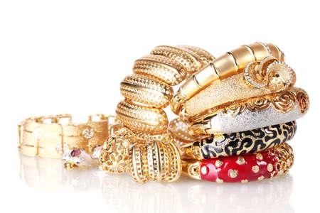 Beautiful golden bracelets isolated on white Stock Photo - 13687599