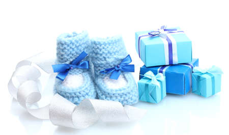 beautiful gifts and baby's bootees isolated on white Stock Photo - 13687210