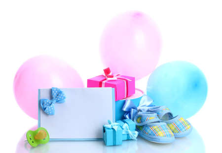 beautiful gifts, baby's bootees, blank postcard, dummy and balloons isolated on white photo