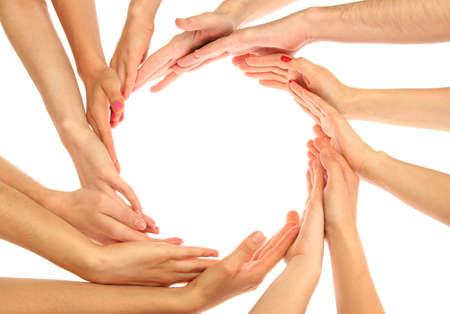 joined hands: grupo de las manos de los j�venes aislados en blanco Foto de archivo