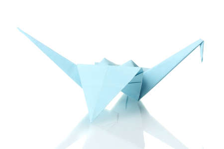 Origami crane  out of the blue paper isolated on white photo