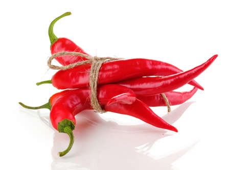 Red hot chili peppers tied with rope isolated on white photo