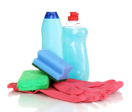 Dishwashing liquids with gloves and sponges isolated on white photo