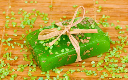 Hand-made herbal soap on wooden mat photo