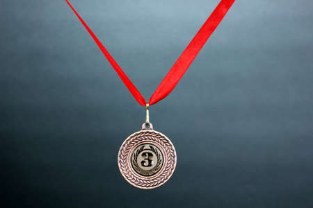 Three medals on grey background Stock Photo - 13810543