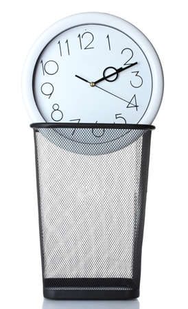 Wall Clock in metal trash bin  isolated on white Stock Photo - 13810366