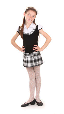 grade schooler: beautiful little girl in school uniform isolated on white