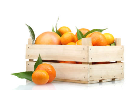 Ripe tasty tangerines with leaves in wooden box isolated on white Stock Photo - 13837491