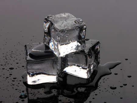 Melting ice cubes on grey background Stock Photo - 13837455