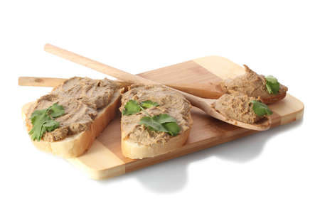 Fresh pate on bread on wooden board isolated on white photo