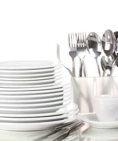 clean kitchen: Clean plates and cutlery isolated on white