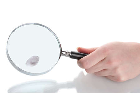 Magnifying glass in hand and fingerprint isolated on white photo