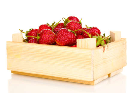 wooden box: Sweet ripe strawberries in crate isolated on white