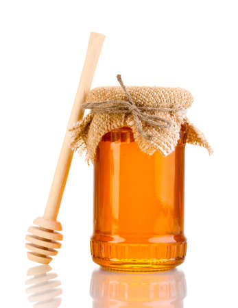 Sweet honey in jar with drizzler isolated on white Stock Photo - 13855905