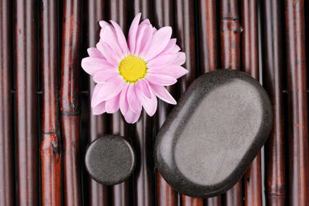 Spa stones and flower on bamboo mat Stock Photo - 13871044