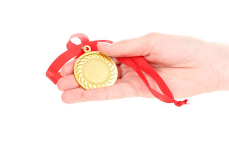 Gold medal in hand isolated on white Stock Photo - 13855837