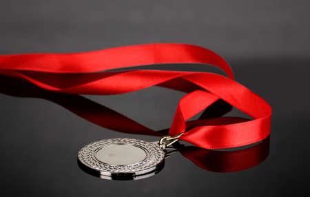 award trophy: Silver medal on grey background