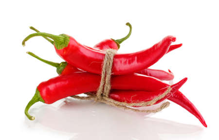 Red hot chili peppers tied with rope isolated on white Stock Photo - 13855807