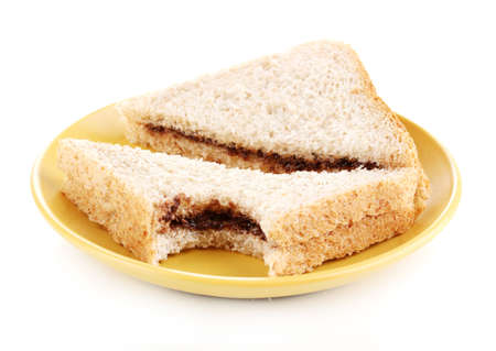 Bitten sandwiches with chocolate on plate isolated on white Stock Photo - 13870505