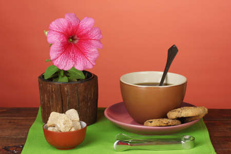 Coffee with sugar for breakfast on a bright colorful background photo