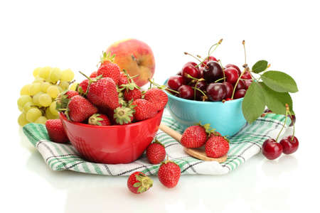 Ripe strawberries and cherry berries in bowls, grapes and apple isolated on white Stock Photo - 13874590
